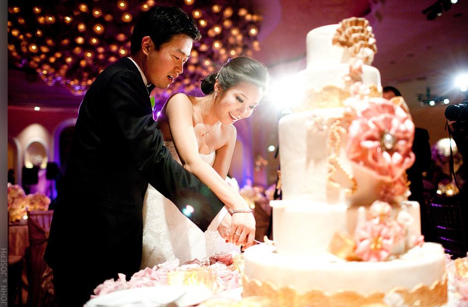 Wedding Cakes Cutting  California wedding Asian bride and groom cut wedding cake