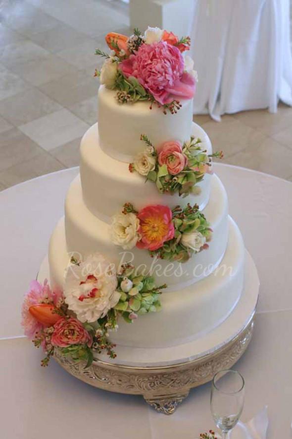 Wedding Cakes Flower  White Wedding Cake with Cascading Fresh Flowers Rose Bakes