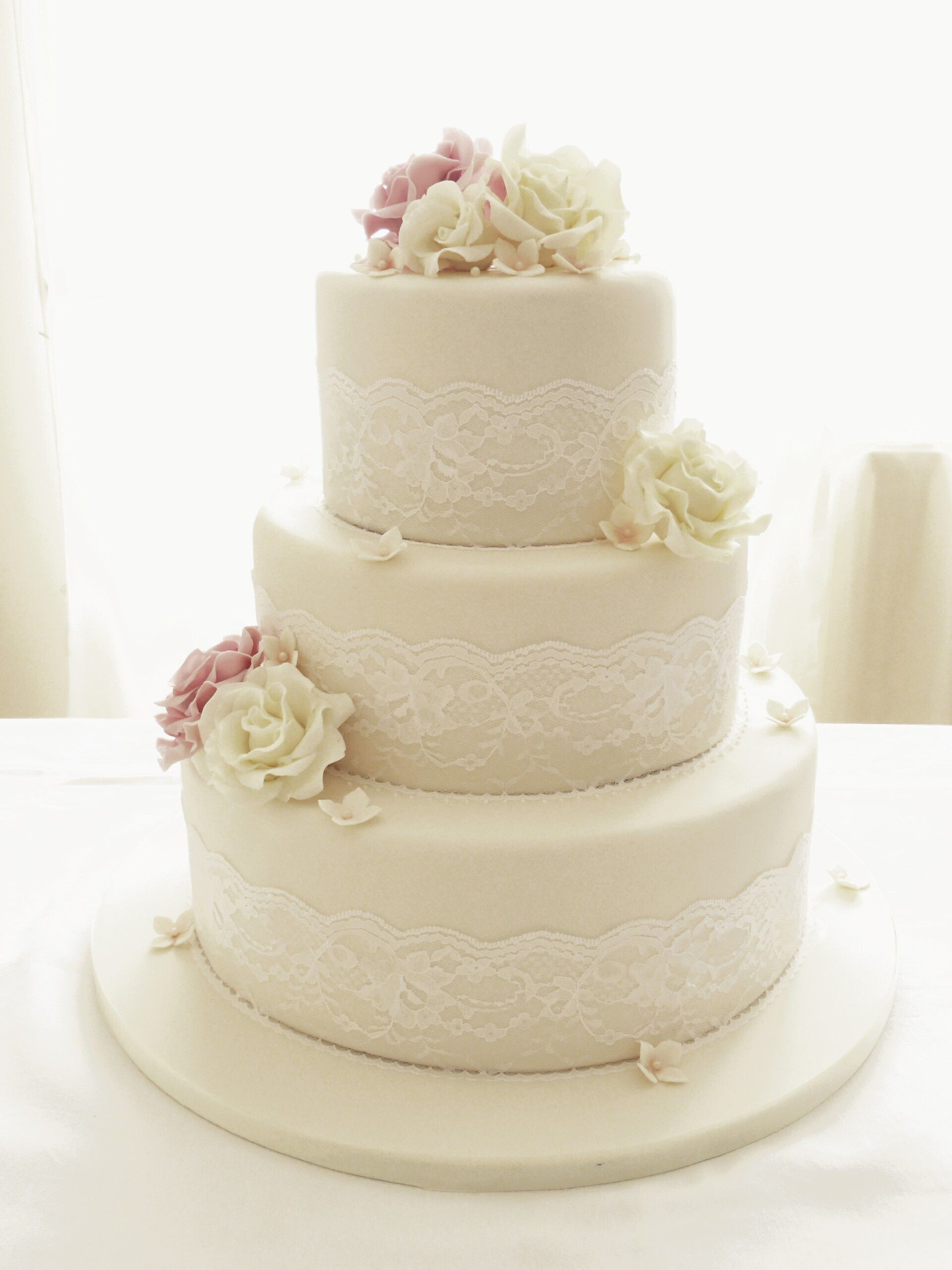 Wedding Cakes Three Tier  Round Wedding Cakes Ivory roses and lace three tier