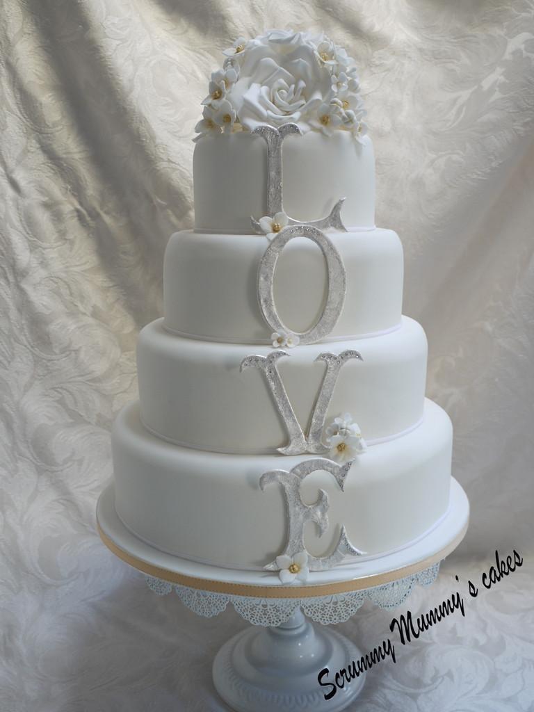 Wedding Cakes Tiered  Scrummy Mummy s Cakes 4 Tier Monogram LOVE Wedding Cake