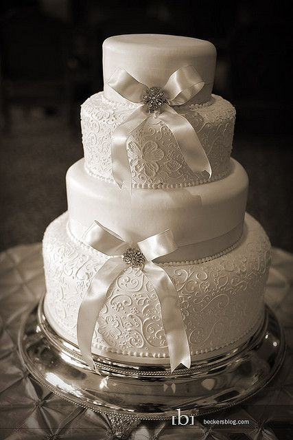 Wedding Cakes With Bows  White lace pattering design white bow round 4 tier