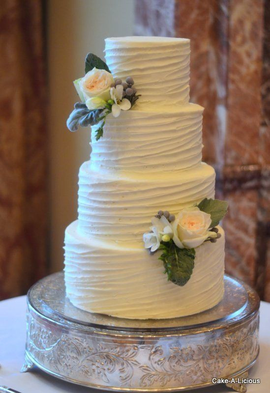 Wedding Cakes With Buttercream Frosting  Simple 2 tier cake with rippled white icing and 2