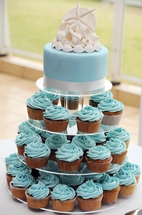 Wedding Cakes With Cupcakes On Tiers  Beach themed cupcake tiers Cupcake Tiers