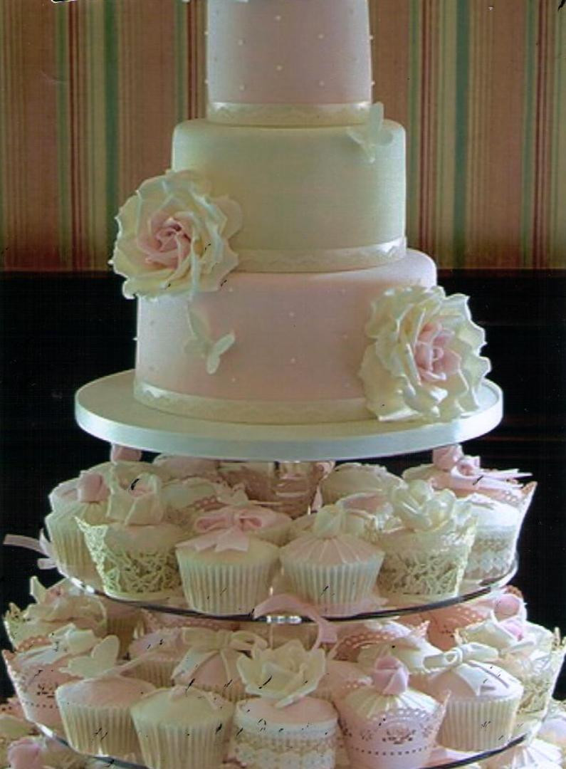 Wedding Cakes With Cupcakes On Tiers  The Cake Zone Sweet battle continues Cupcakes vs