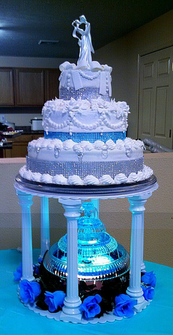 Wedding Cakes With Fountains And Lights  Three tiered silver and teal aqua blue wedding cake with