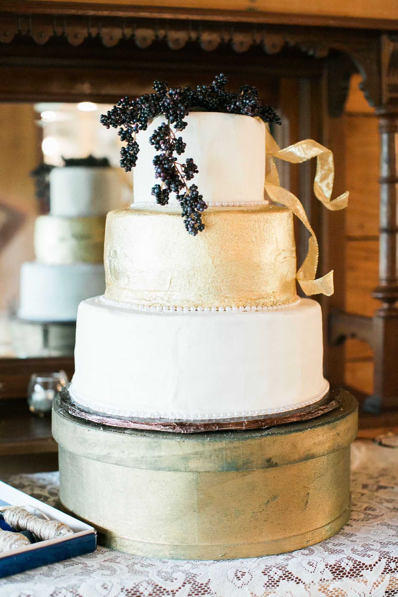 Wedding Cakes With Gold Accents  Gold Wedding Cake With Blue Berry Accents