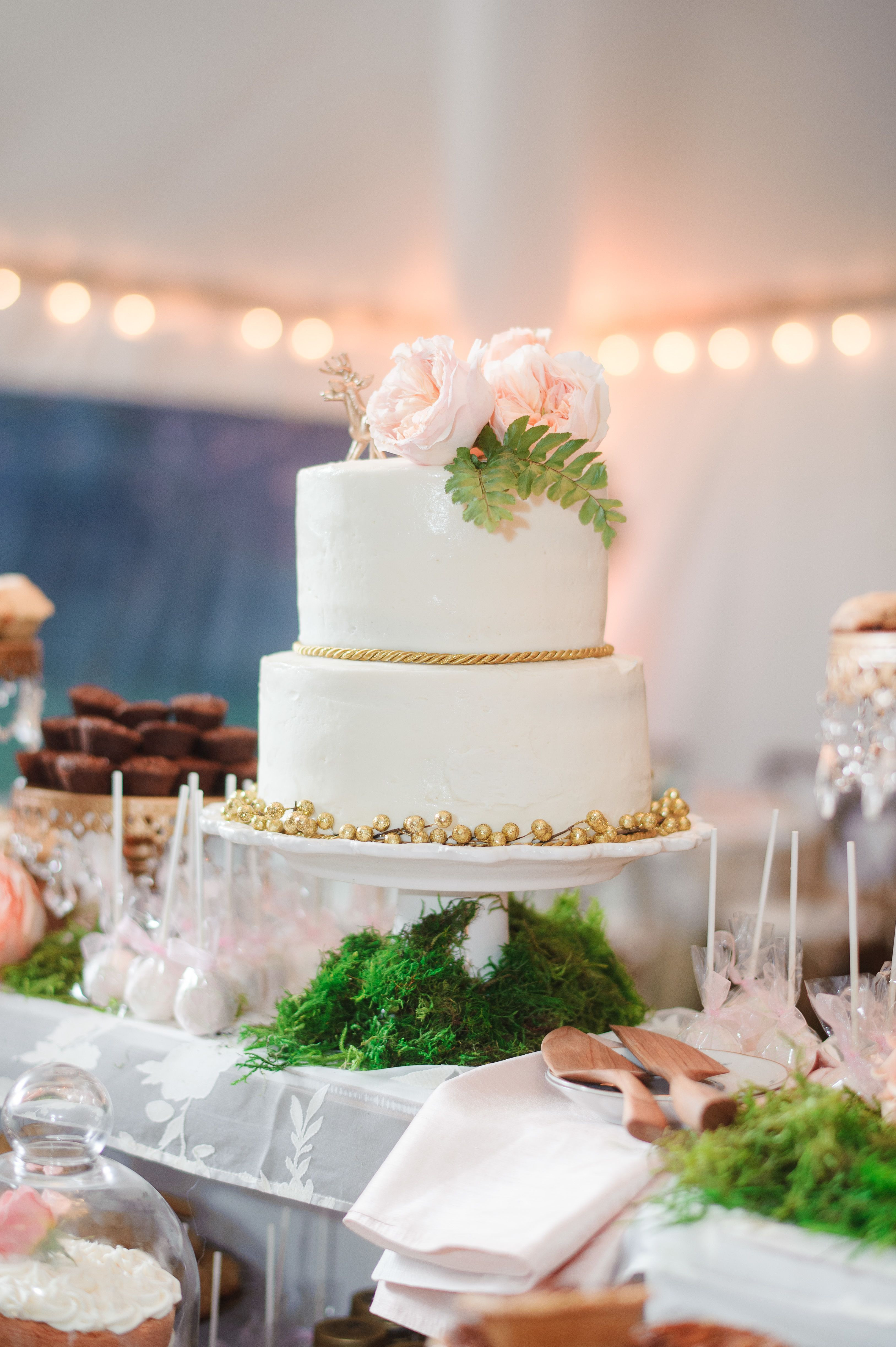 Wedding Cakes With Gold Accents  Tiered White Wedding Cake with Gold Accents