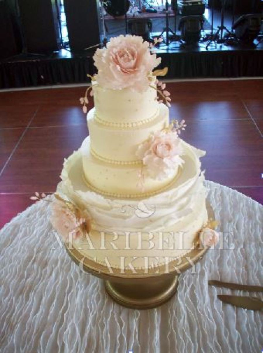 Wedding Cakes With Gold Accents  Blush And Gold Accents A Buttercream Wedding Cake