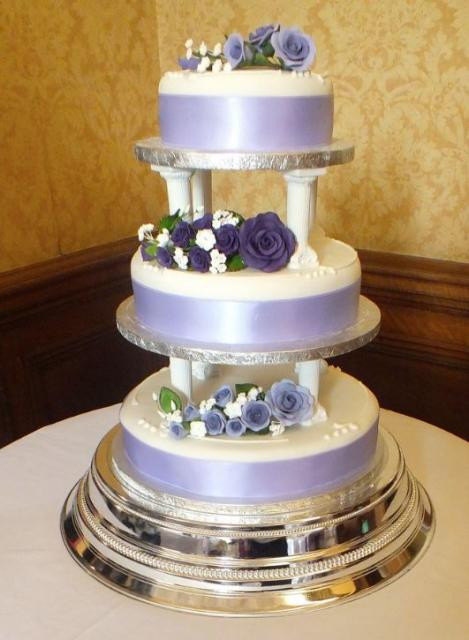Wedding Cakes With Pillars  3 tier lavender and white wedding cake pillars between