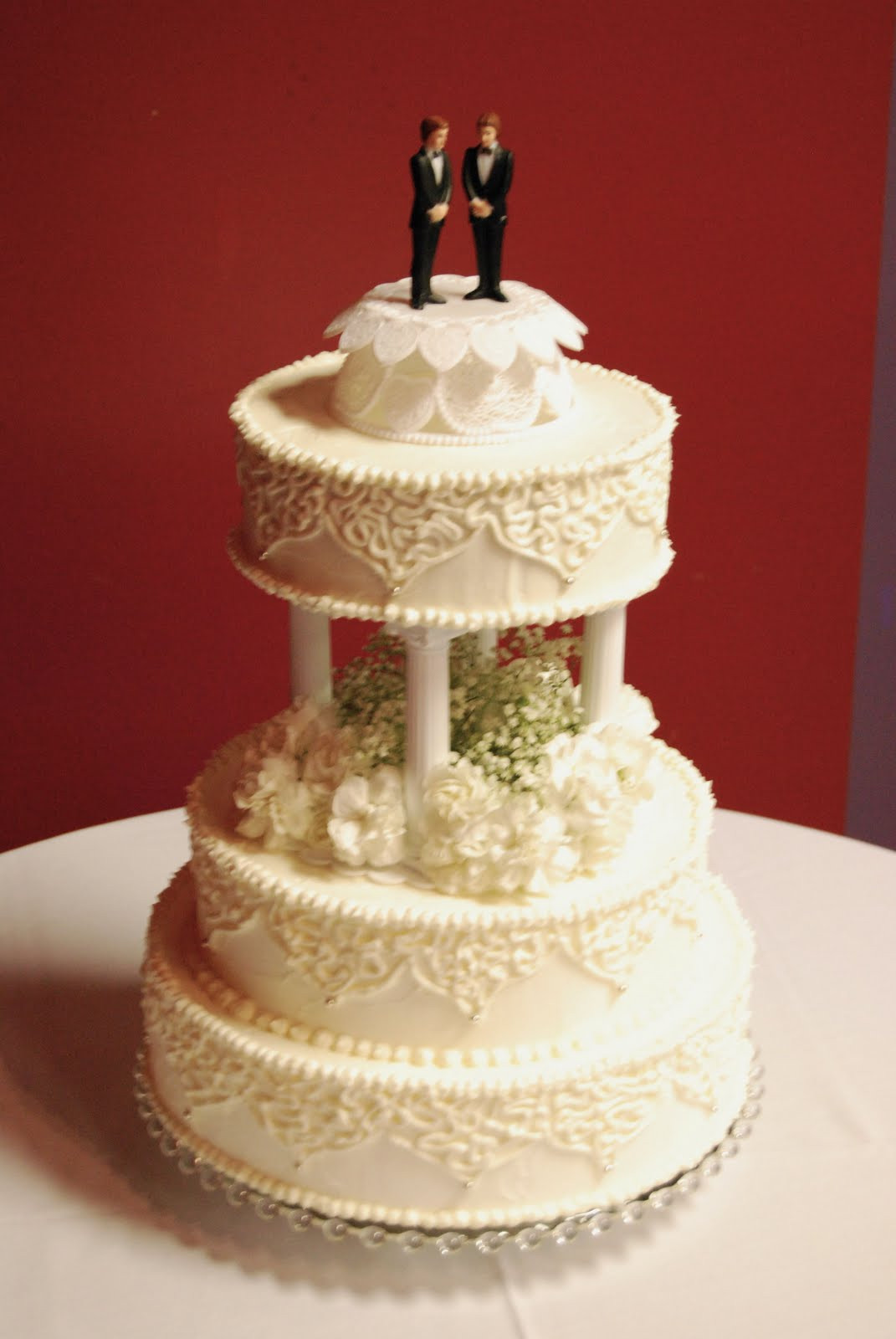 Wedding Cakes With Pillars  Everything Is Frosted Traditional wedding cake with