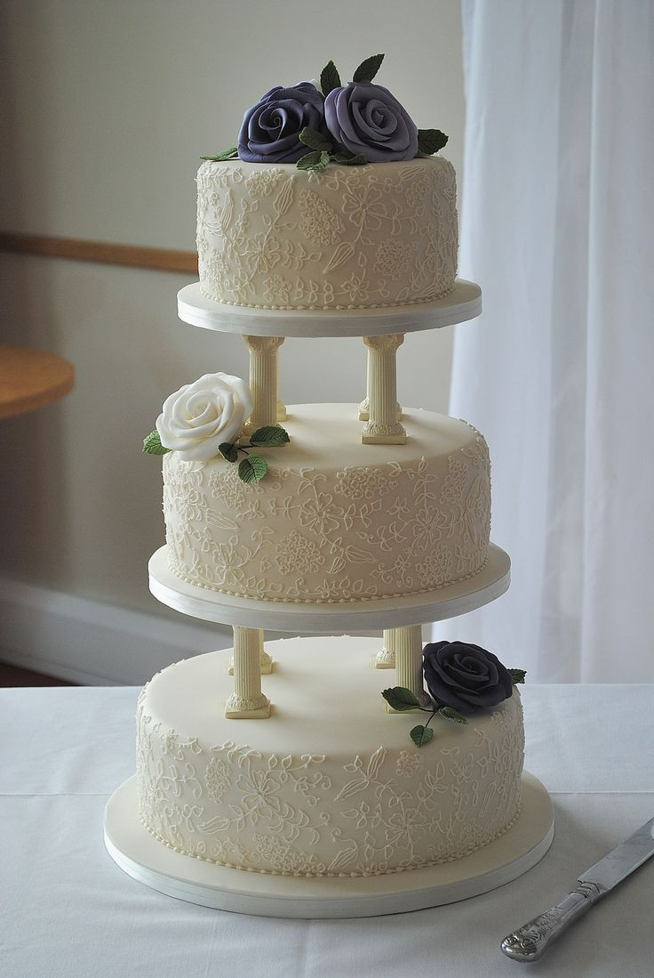 Wedding Cakes With Pillars  3 tier wedding cake with pillars hand piped lace and hand