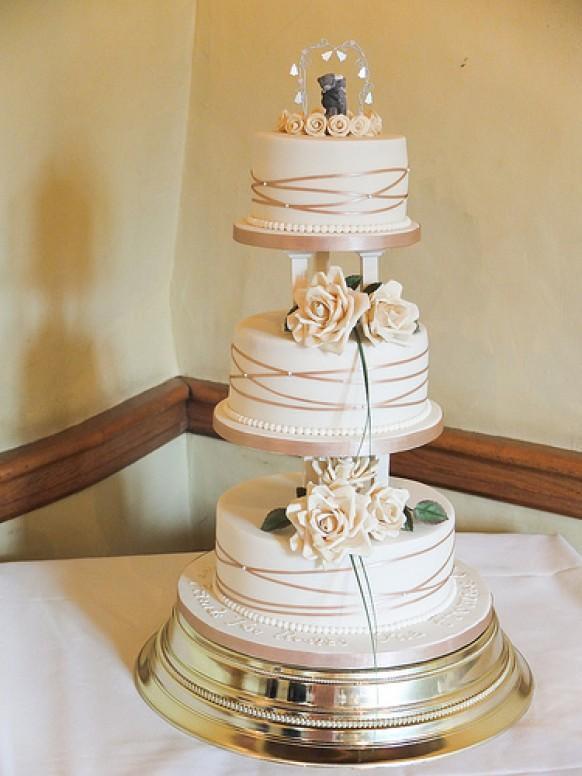 Wedding Cakes With Pillars  Ivory Wedding Gold & Ivory Cake With Pillars