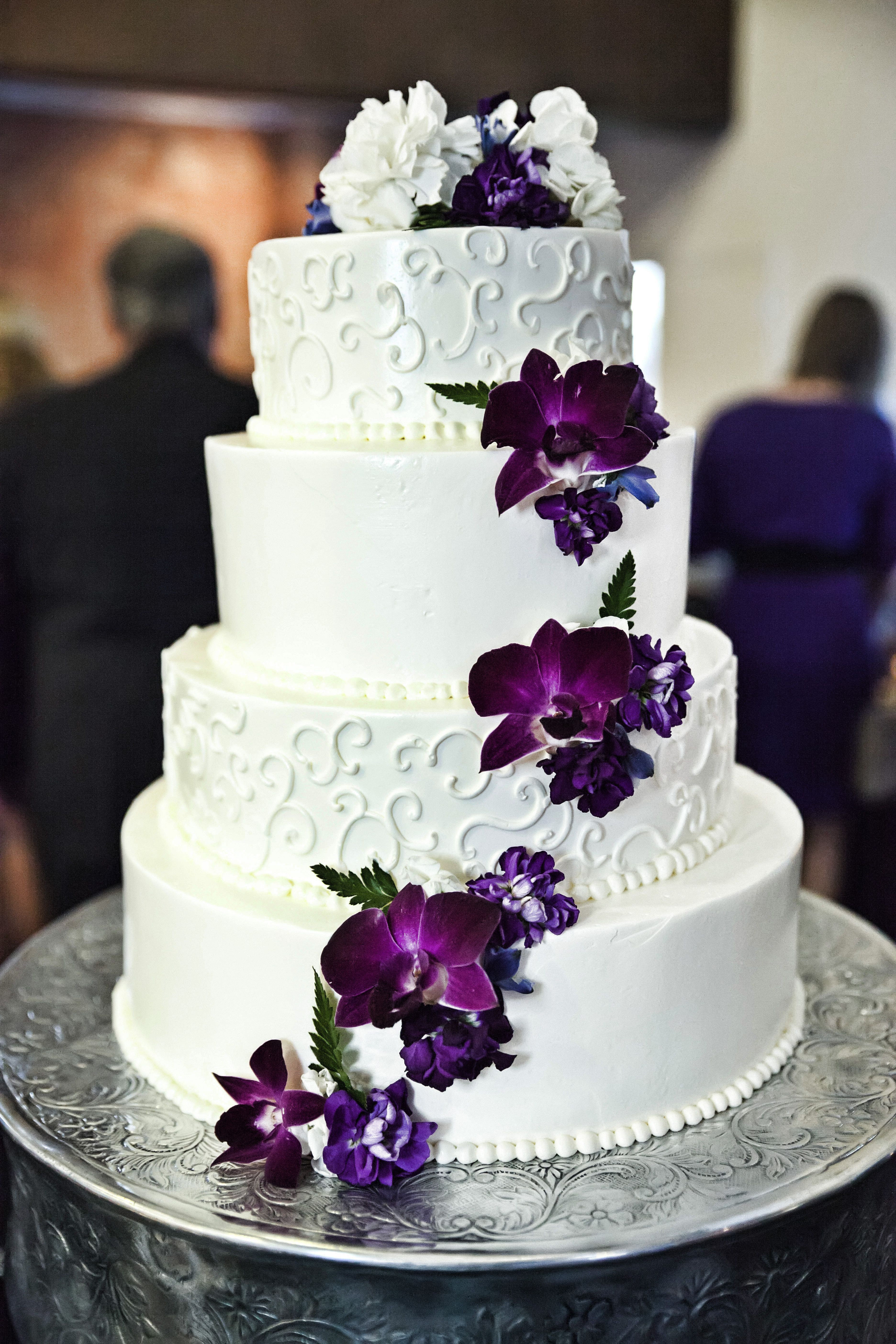 Wedding Cakes With Purple Flowers  White and purple wedding cake with cascading purple