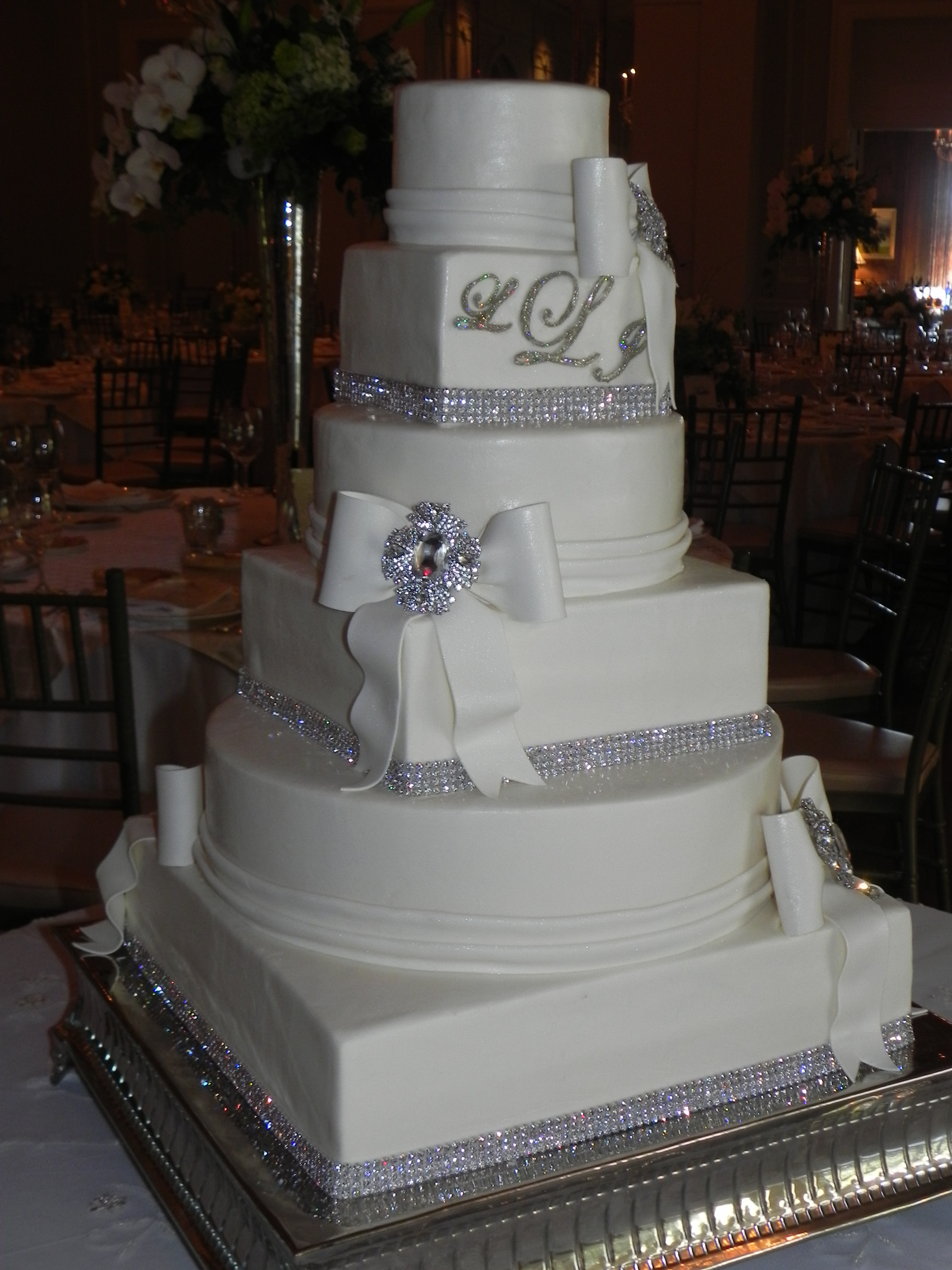 Wedding Cakes With Rhinestones  Rhinestones and brooches wedding cake with bows and
