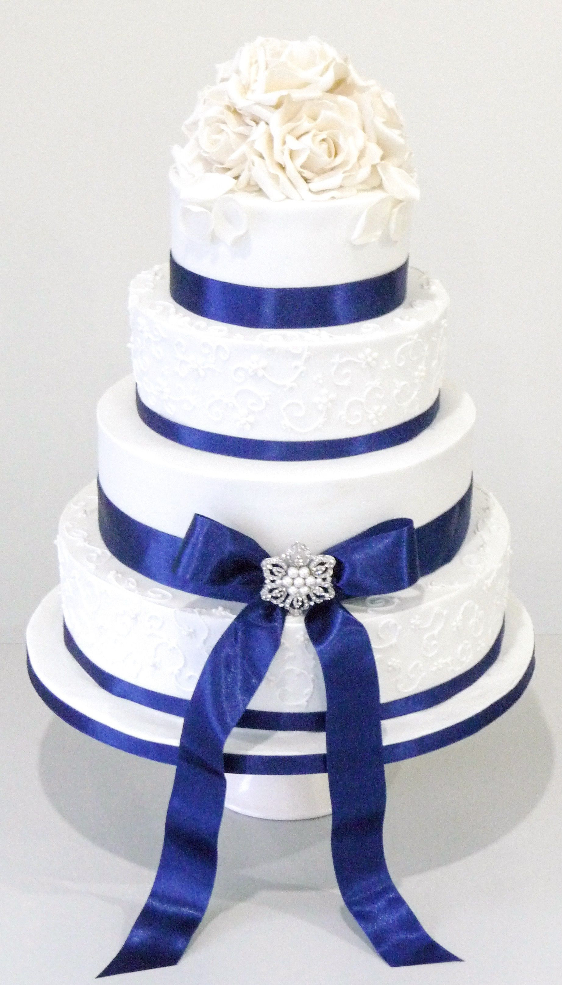 Wedding Cakes With Ribbons  White sugar flowers on this 4 tier wedding cake with Royal