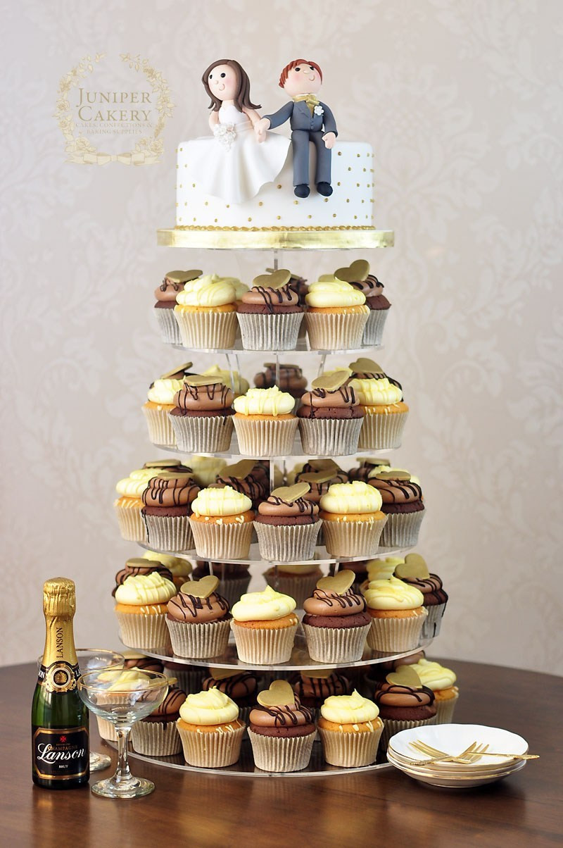 Wedding Cupcakes Towers  Fun Wedding Cupcake Tower with Bride and Groom