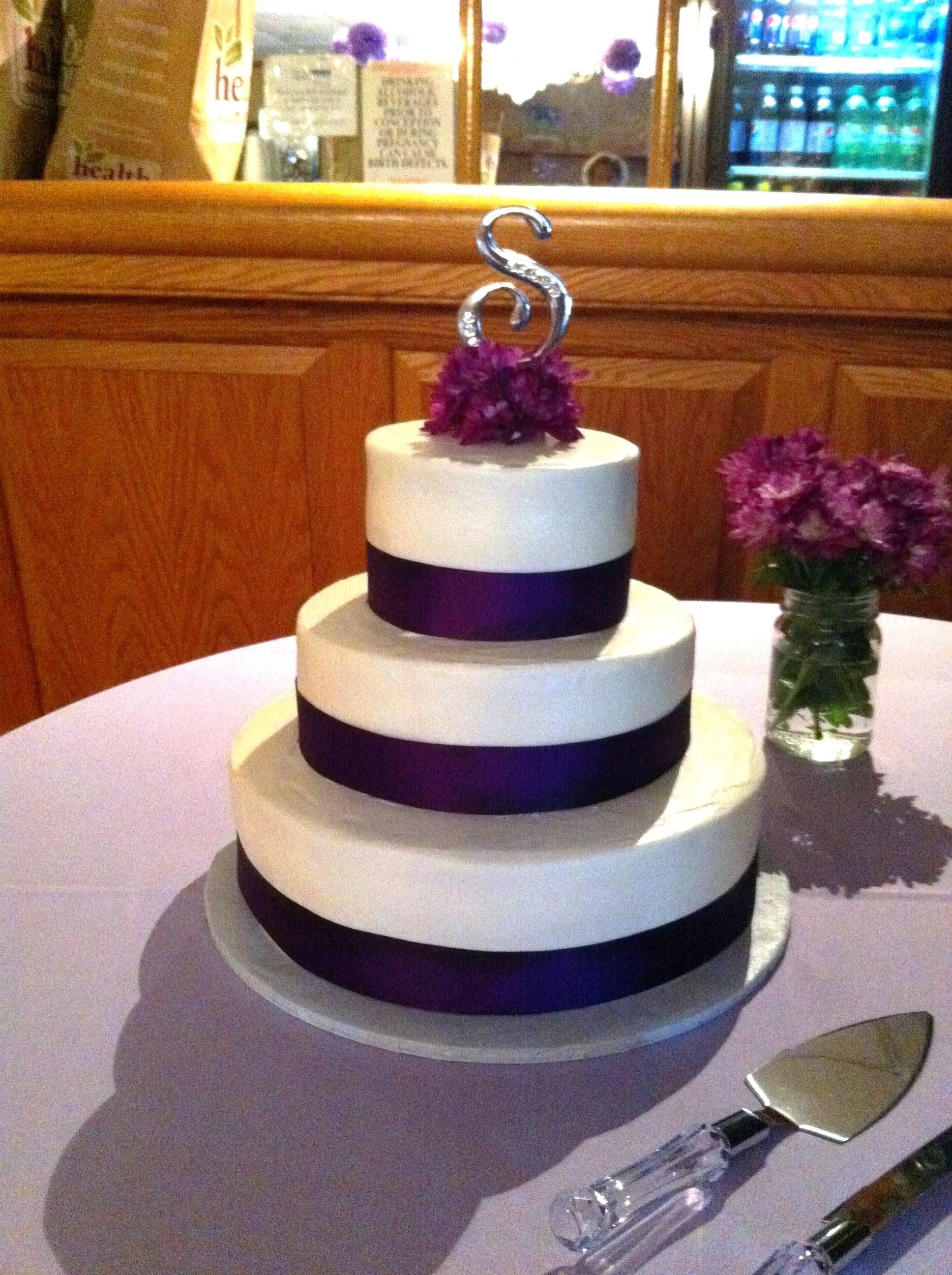 White And Purple Wedding Cake  Classic White Wedding Cake w Purple Decorations