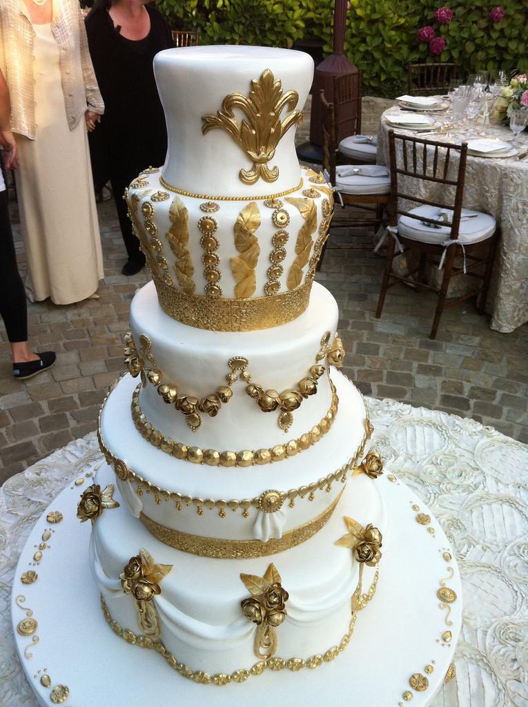 White Gold Wedding Cakes  gold and white wedding cake Robyn Van Tuyl