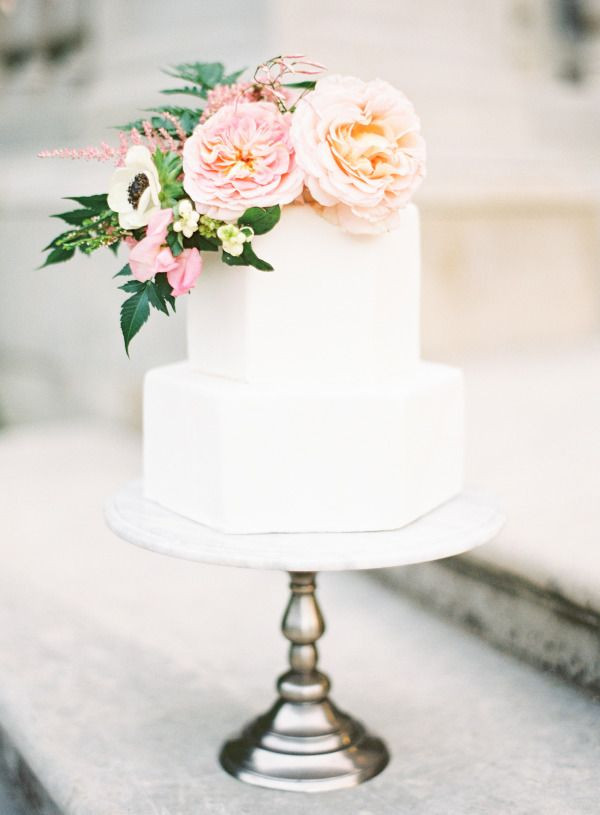 White Wedding Cake With Flowers  Geometric white wedding cake with pastel flowers