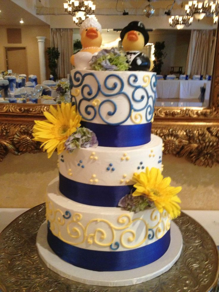 Yellow And Blue Wedding Cake  Royal blue and yellow buttercream wedding cake with blue