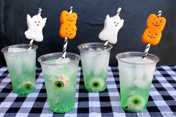 Easy Halloween Alcoholic Drinks  easy halloween drink with peep straws A girl and a glue gun