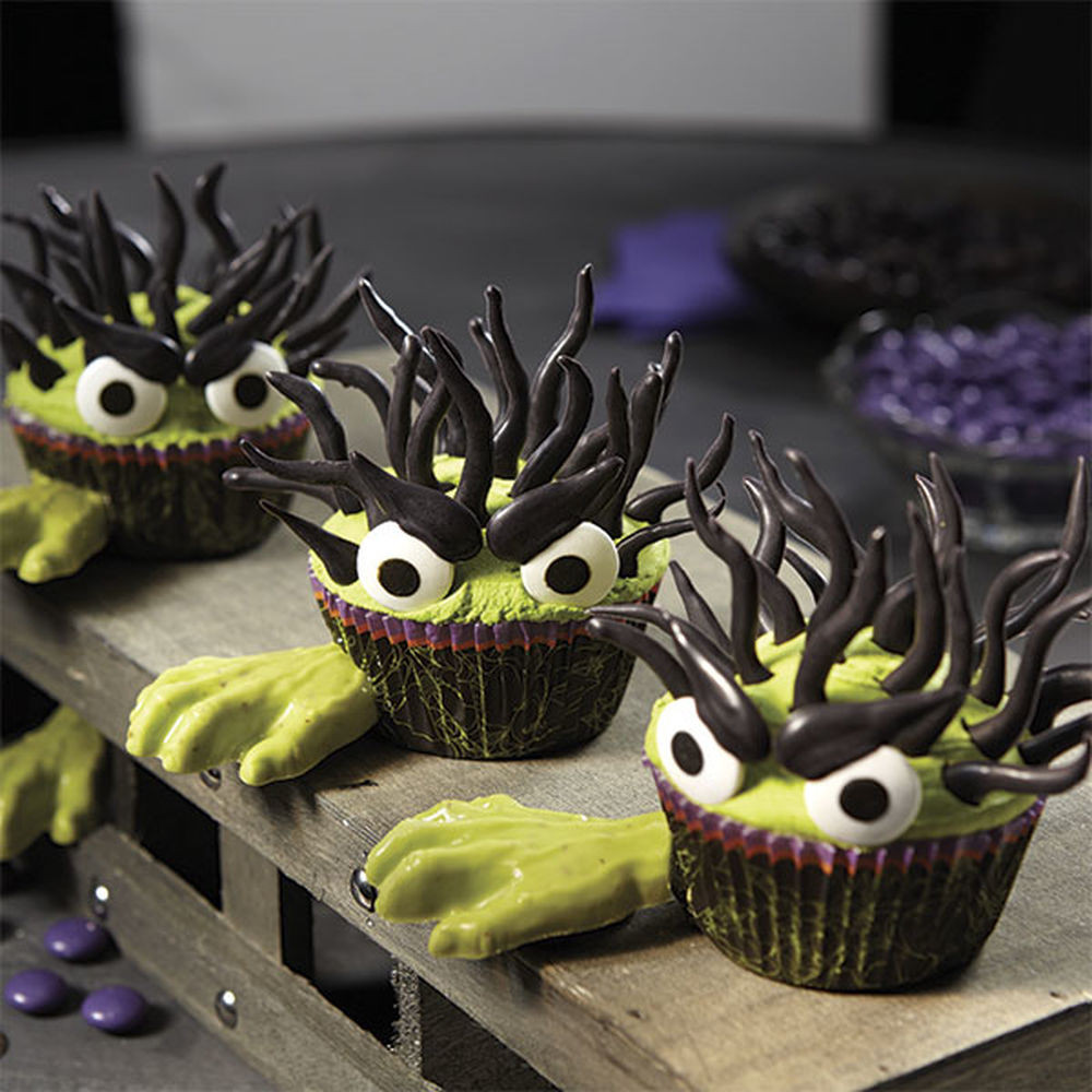 Halloween Monster Cupcakes  Halloween Monster Cupcakes With Candy Hands