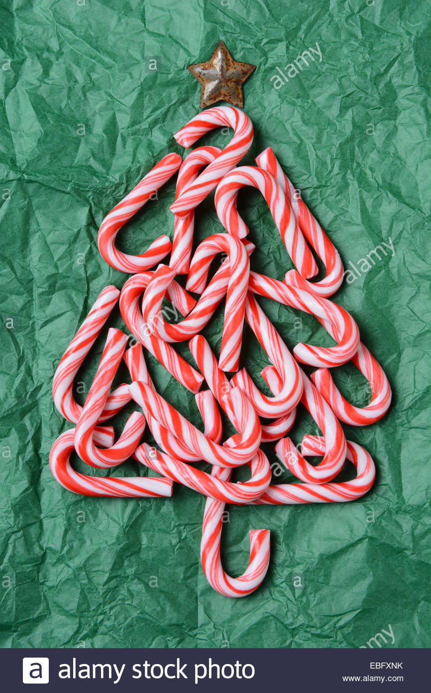 Why Are Candy Canes Associated With Christmas  Christmas tree shape made out of candy canes on a green